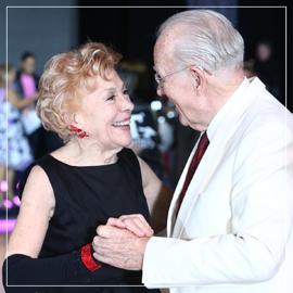 Older couple dancing in a ballroom